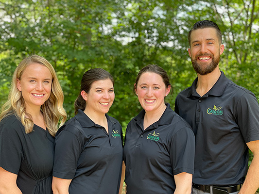 Chiropractor Greenville SC Andy Wright with Team